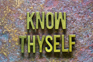 know thyself phrase made from metallic letters over rusty metallic background